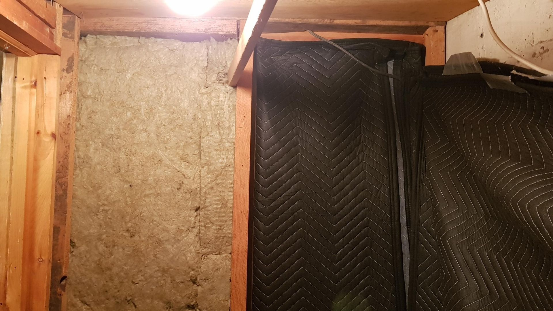 With 2 layers of moving blankets over the sound insulation the vocal booth sounds great